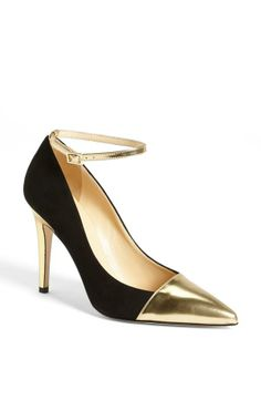 Gold and black pumps