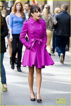 Lea Michele wears a fuschia coat while walking around the set of her show Glee in the theatre district of New York City. #Hollywood #Fashion #Style