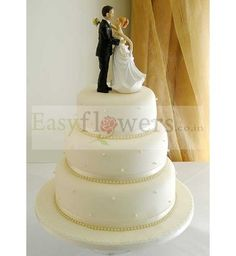 The cake for the most special occasion of anyone's life is very special. It should be good to eyes as well as soothing to the tongue. The 3 tier cake is available in three wonderful flavors, butter scotch, pineapple and chocolate. #WeddingCake #EasyFlowers