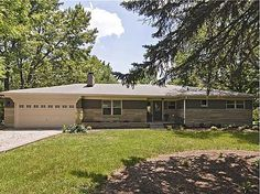 Gorgeous, completely remodeled 3BR/3.5BA Ranch on the northside of Eagle Creek Park. Wonderful 1/2 acre lot, wooded setting, very private w/ no backyard neighbors & quiet street. Terrific Kitchen w/SS appliances & granite countertops, brand new paint & flooring throughout house, Master on main, custom tile work in all 3 remodeled full Baths & hand-made Built-ins throughout. #zillow
