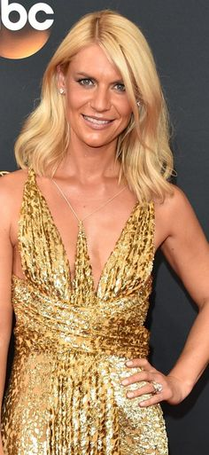 Homeland's Claire Danes sparkled in a gold sequined Schiaparelli gown and Forevermark diamonds. Her Emmys jewelry look included a two-stone diamond ring and diamond studs.