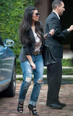 jeans... is it just me or does she look like she picking her crotch?
