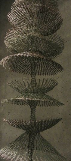 Ruth Asawa is a San Francisco based Japanese artist who does sculpture work including many pieces that are crocheted with metal.