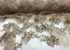Check out this item in my Etsy shop https://www.etsy.com/listing/218337023/luxurious-bridal-beaded-wedding-lace