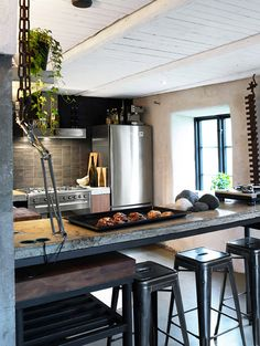 metal refrigerator, dark tiles...awesome for outside/patio kitchen