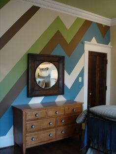 Hmm, doing this on the focal wall (in grey, white, red, and blue) might be way easier than chevroning or striping!