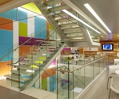 A colorful feature staircase connects the three upper floors of the building, opening up the space. Photography by Craig Dugan.