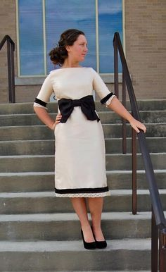 Cream Dainty Jewells dress with black bow