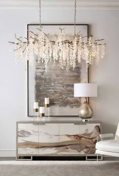 Monochromatic entranceway with gorgeous etherial chandelier.