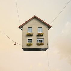 """The French photographer Laurent Chéhère in partnership with Galerie Paris-Beijing displayed the """"Flying Houses"""" series utilizing photography and digital manipulation. Buildings were isolated from their urban context and not showing… Photography Projects, Art Photography, Photography Exhibition, Artistic Photography, Creative Photography, Floating House, French Photographers, Pics Art, Architecture Design"""