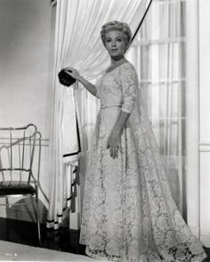 Lana Turner - Imitation of Life  I love this movie and I absolutely love her wardrobe in it