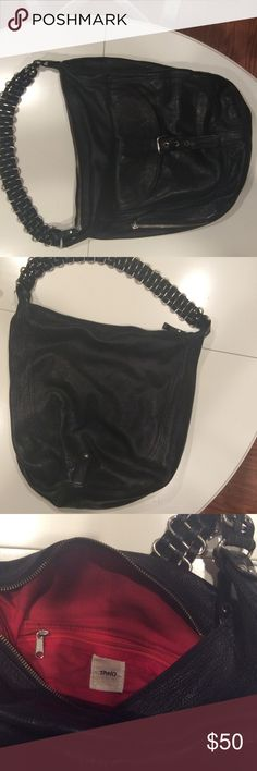 Tano hobo from Anthropologie Black pebbled leather hobo from Tano purchased from Anthropologie. Red interior. Several pockets inside and out giving plenty of storage . Handle is braided leather and metal. Exterior is excellent, interior is clean but has some marks from normal wear. Very sturdy fashionable bag. Anthropologie Bags Hobos