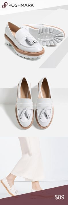 Zara shoes New with tag. EUR 37 US 6.5. Fits size 6.6/7. Flat white leather shoes. Tassel detail on strap. Constarting white and beige track sole. Heel height of 4 cm. Upper: 90% cow leather Lining: 100% polyurethane Sole: 100% thermoplastic rubber Slipsole: 100% goat leathere Zara Shoes