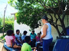 """Why is building our own Enrichment Center important? Here's @megtingle teaching kids out of the back of the truck due to scheduling conflicts. Our own Enrichment Center would provide us a safe place to tutor as well as host other events special functions. You can give at our website http://ift.tt/1MRtiJm on the """"I want to give"""" button! ----------------------------------------- #Jesus #ministry #devotional #inspirational #missions #pastor #jesuschrist #liveauthentic #youth #volunteer…"""