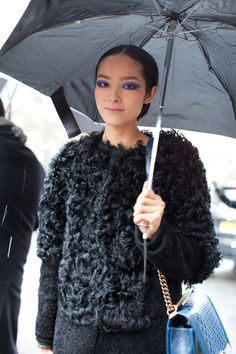 Runway makeup makes it to the street for a pop of color on all black.
