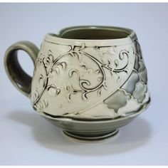 I am interested in the way that presenting two different surfaces in the same cup offers the user the oppertunity to combine them in their imagination to create an experience that nourishes the mind and the body. Thrown porcelain, trailed slip and original trailed glazes, underglaze wash. .:. .:. .:. .:. .:. #cup #mugshot #gray #pottery #artpottery #coffeecup #ceramics #thoughtsonpots #claylife #pottersofinstagram #cupoftea #ceramicart #oneofakind