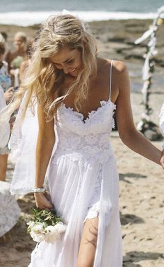 Sexy elegant Grace Loves Lace wedding dress for a beach wedding. Click through to see more;