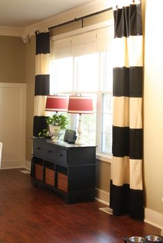 I love these striped drapes and the lamps. (originally from www.theyellowcapecod.com)