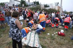 Emergency personnel work on victims the scene of the train derailment in Santiago de Compostela, Spain, on Wednesday, July 24.
