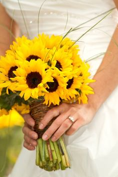 Summer wedding flowers in full bloom! This is a beautiful example of how to create a bridal bouquet with simply sunflowers.