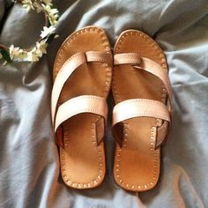 Brand new Bohemian handmade nude leather slippers So comfy and trendy . Handmade in India , genuine leather , vegetable dyed . They do run a size small so these are a size 9 which means they will fit a sz 8 to 8 1/2 perfect. Shoes Slippers
