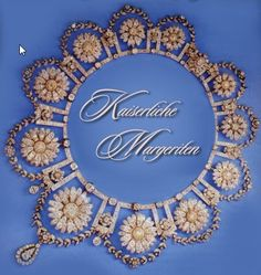 Empress Eugenie was the great beauty and fashionable wife of Napoleon III.  Her love of flowers and jewels is well documented so her husband presented her a  combination of both: 15 diamond-marguerites as a parure, with earrings and necklace made by the French jeweller Dumoret.