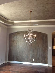 Modern Masters metallic plasters on ceiling and accent wall by Karla Boddie of Luxe Faux