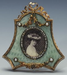 Frame with photograph of HRH Maud, Princess Carl of Denmark Creator: Johann Victor Aarne , c. 1905 Gold, silver-gilt, guilloché enamel, pearls, diamonds, mother-of-pearl.Mark of Viktor Aarne; FABERGÉ in Cyrillic; gold mark of 56 zolotniks and silver mark of 88 zolotniks