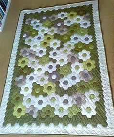 Grandmother's Flower Garden in Greens   Lise made the lovely Grandmother's Flower Garden using greens. Hand-pieced and hand-quilted. Measures 140 x 210 cm. April 2015