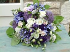 Love the mix of dark, pale blue & violet with pale roses. Violet eustoma, lavender coloured trachelium, inky blue agapanthus, with creamy Avalanche roses and delicate blush 'Vendella' roses.