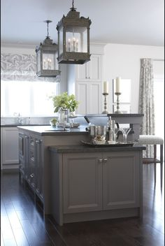 a little busy but like the lighting and grey island verses white outer cabinets