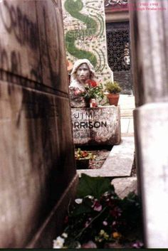 Jim Morrison's grave. I visited here twice. Once in 83 and once in 86. It was a mess. I tried to clean it up. There was a broom nearby and I started sweeping. Some guy came along with a bottle of wine and while glaring at me poured the entire bottle on the grave.
