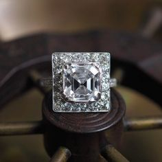 In a perfect example of the garland style's transition into Art Deco, the geometric lines of this spectacular 3.02ct E VS1 Asscher ring are offset by luxe details like fine milgrain borders, a hand engraved bezel, and delicate filigree in the gallery. DM for details #jogani #joganibh⠀ .⠀ 3.02ct Asscher E VS1 GIA⠀ .⠀