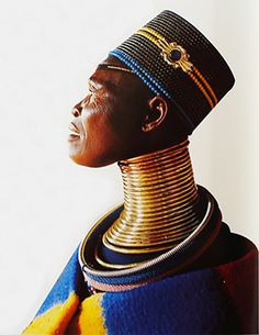 Ukuva iAfrica Ndebele woman with neck rings. In Africa, many of the tribal women - like the Ndebele - wear metal rings or beaded hoops around their necks. These rings as well as other traditional, beaded adornments and ornaments symbolise the woman's (and her family's) status in society.