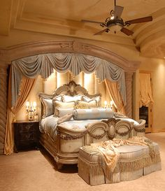 Love the padded wall behind the bed and doesn't necessarily need the draping Master bedroom