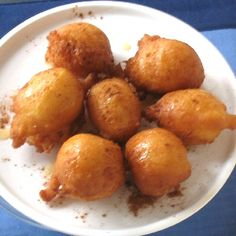 These deep-fried puffs, drizzled with honey, are a New Year's Eve tradition in many parts of Greece and a sweet enjoyed at Hanukkah.  Step by step photos show you how to make them.