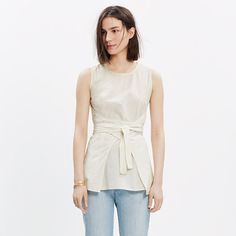 This top is so out of my price-range, but absolutely stunning! I love the simple, yet architectural look it possesses.
