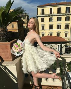 Elle Fanning in a white whimsical dress with a rose colored satin ribbon Girl Crushes, Dakota Fanning Y Elle, Elle Moda, Fanning Sisters, Roman Holiday, Bridesmaid Dresses, Wedding Dresses, Celebs, Celebrities