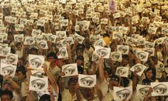 People, holding placards of a bleeding eye, take part in a demonstration in front of the Presidential Office in Taipei August 3, 2013. REUTERS/Steven Chen