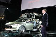 The new Tesla Model X. Coolest car ever. Electric SUV that looks like it can travel through time.