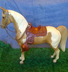 Breyer Western Horse Palomino with Removable saddle....I swear I have this same model that's really old. Doesn't have a saddle with it, and it's like a light banana yellow color.
