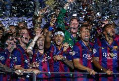 Neymar of Barcelona celebrates victory with team mates after the UEFA Champions League Final between Juventus and FC Barcelona at Olympiastadion on June 6, 2015 in Berlin, Germany.