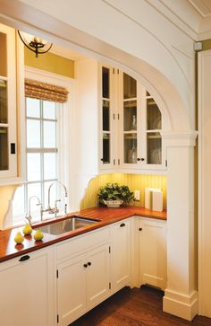 Wood Counter Tops for the Kitchen - Town & Country Living - Traditional Yellow Kitchen with Glass Front Cabinets Best Picture For kitchen lighting For Your T - 1930s Kitchen, New Kitchen, Vintage Kitchen, Kitchen Decor, Kitchen Ideas, Kitchen Pantry, Wooden Kitchen, Kitchen Modular, Vintage Cabinet