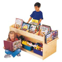 Book Browser - School & Play Furniture Mobile cart for displaying books plus storage below for puppets and supplies. Book display easels on both ends. Preschool Furniture, Wood Book, Preschool Books, Preschool Crafts, Thing 1, Book Storage, Kids Storage, Early Learning, Book Crafts