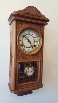 THANK YOU for stopping by our listings here on Etsy!  You are viewing a completely original, professionally Restored Chiming Wall Clock model from D&A Clock Co. This clock has been professionally serviced by our own in-house master clockmaker and it is certified to as-new mechanical condition. It is in flawless working order. The original mechanical clockworks have been removed, rebuilt to as-new condition & then reinstalled in the original case. FEATURES: • Original 31 - day, key wind…