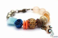 Handmade bracelet in brown and peach by Janine Lucas from Esfera Jewelry
