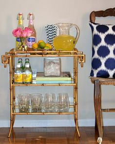 display your vintage bar glasses on a chic bar cart
