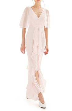 Airy, romantic, and light this cascading chiffon dress is designed to make you look timeless on your big day