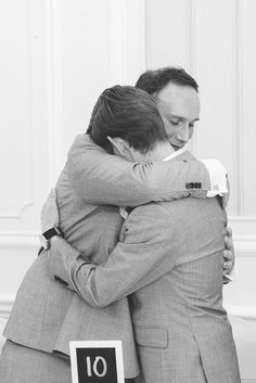 An embrace between the groom and best man, I love these 2