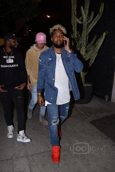 Odell Beckham Jr. wearing Nike Air Yeezy 2 Sneakers, Amiri Destroyed Denim Shirt